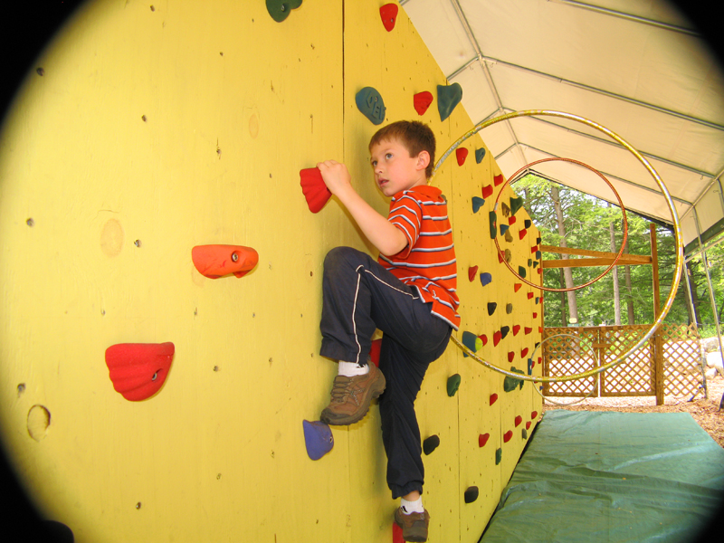 Tyler on Rock Wall2 web.jpg